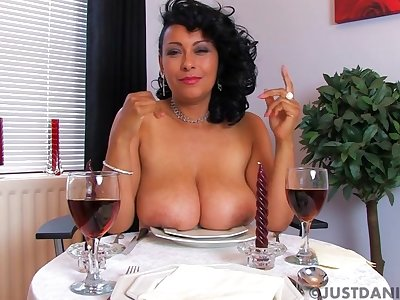 Danica Collins takes off her attire to tease during a diner