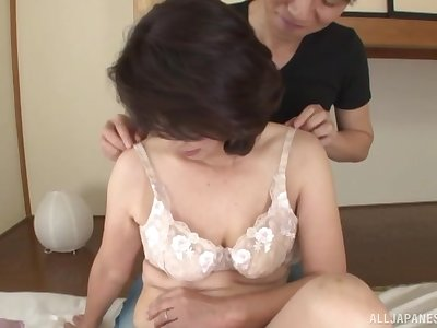 Seductive Japanese mature enjoys small fry for sex