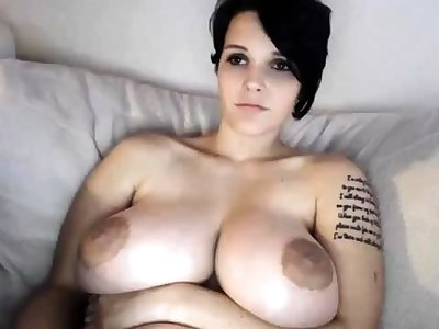 Busty MILF toys her pussy on webcam