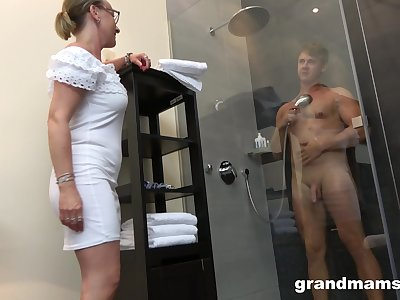 Old latitudinarian with high sex drive enjoys watching young man taking a shower before having sex