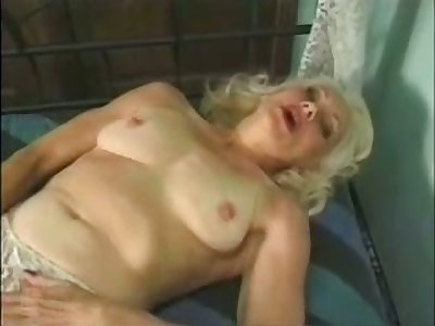 Full-grown auburn bawd masturbates her wet old pussy with a trifle