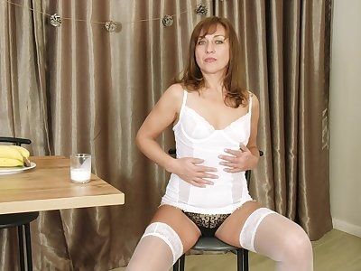Sex-appeal older unsubtle Rafaella shows striptease and plays with pussy