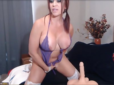 Hot mature wed with red hair, is sucking a chubby fake locate and toying her pussy.