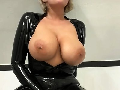 Busty amateur milf wears latex perpetual and high heels