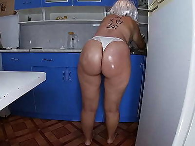 Mom washed the dishes close by the kitchen and took the stepson's penis close by her hand and inserted it into her anal