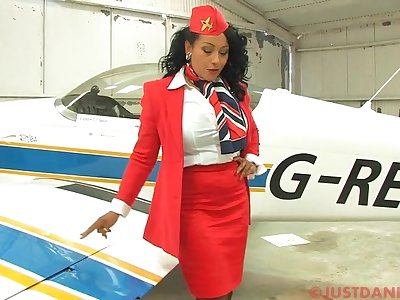 Busty stewardess Danica Collins takes off her camiknickers to twitting